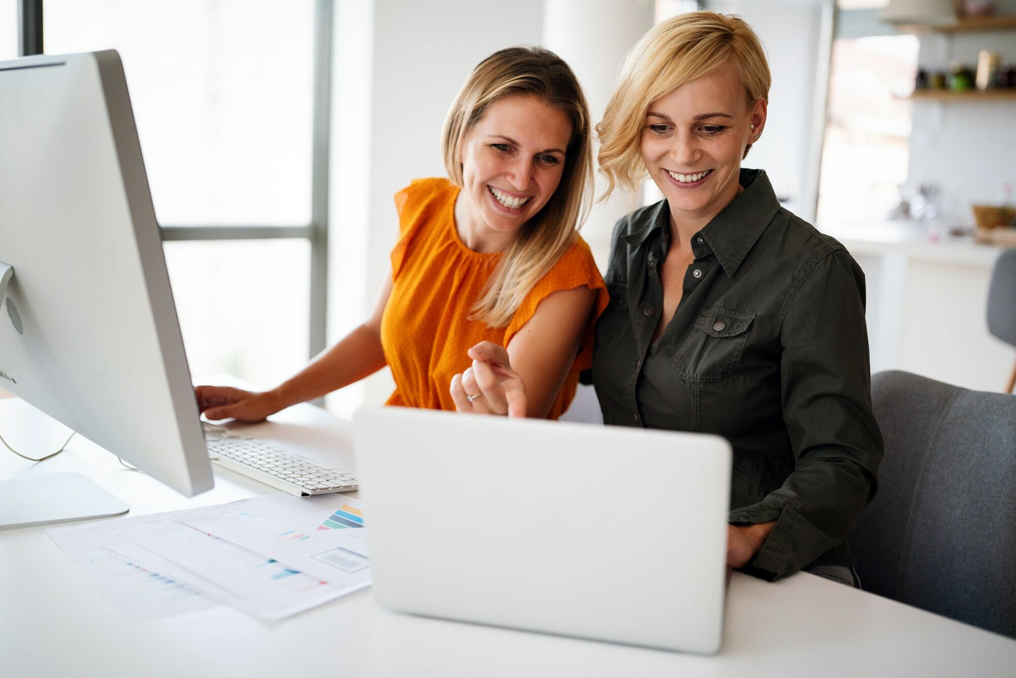 Business women working at the office on computer